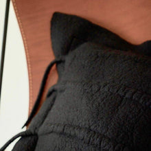 Load image into Gallery viewer, This intricate headrest, mimicking a centipede cushion cover, is best at its own, matched with a simple throw. Shongololo is neutral in its colors but adds style through its naturally felted feelers. Each cushion is made individually to allow for the raw edge folded top. It is aimed to be at the heart of a modern home.
