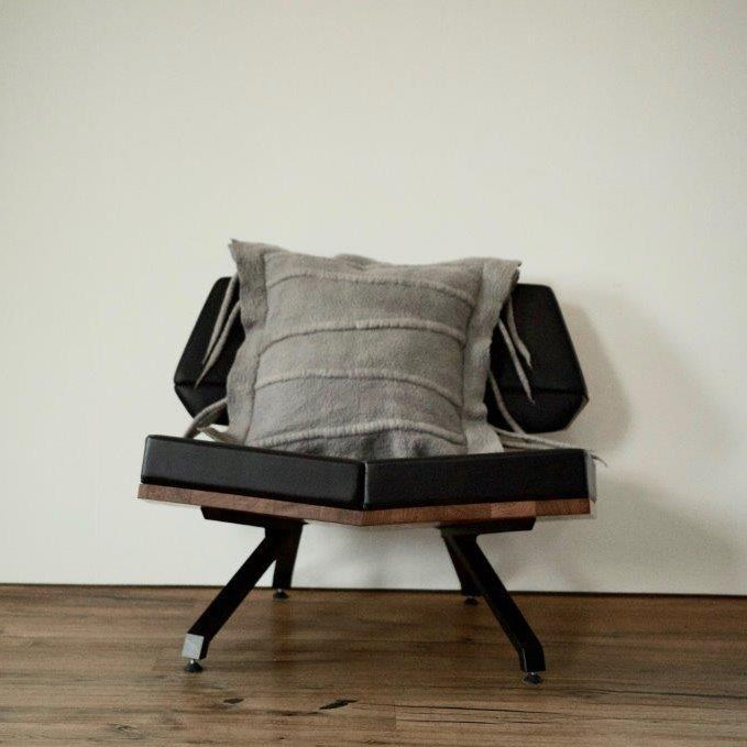 This intricate headrest, mimicking a centipede cushion cover, is best at its own, matched with a simple throw. Shongololo is neutral in its colors but adds style through its naturally felted feelers. Each cushion is made individually to allow for the raw edge folded top. It is aimed to be at the heart of a modern home.