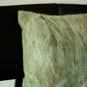 These varied cushions hand you a large choice of different colors and sizes. The mix of the two colors gives the cushion a mystic look, and the Mohair wool lends it a soft touch of gloss. Merino/Mohair Wrapped scatter cushio