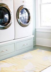 You'd be hard-pressed to find someone who enjoys laundry, but that doesn't mean your laundry room has to look like a room that time forgot