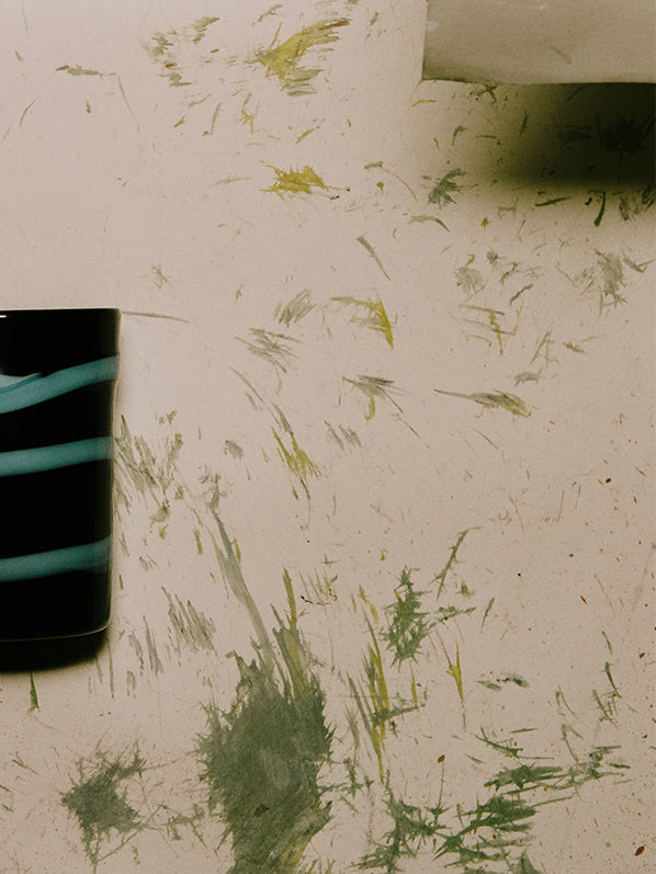 MURANO GLASS, BLACK WITH CYAN STRIPES