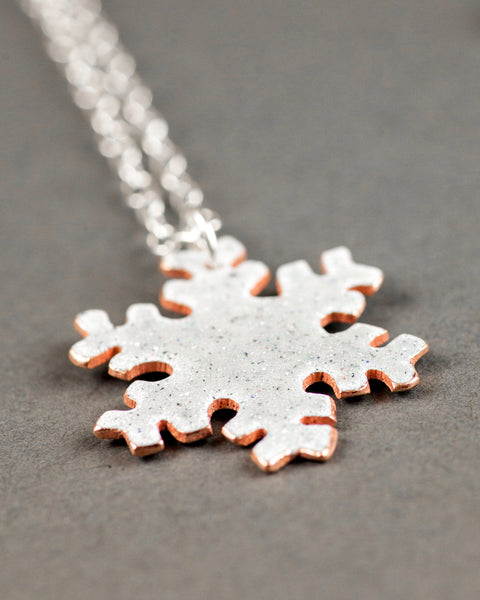 Reversible snow flake necklace