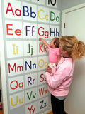 baby looking at alphabet repositionable wall decals