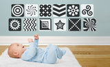 baby looking at black & white repositionable wall decal images on wall