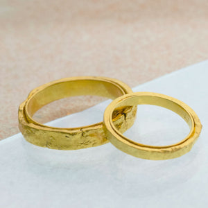 Two beautiful and unusual wedding bands, with rough organic texture. Made in recycled silver plated with 24ct gold.