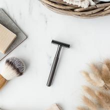Load image into Gallery viewer, Matte Black safety razor on a marbled background with shaving soap and shaving brush - Shoreline Shaving UK