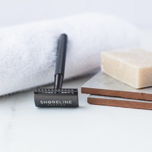 Load image into Gallery viewer, Closeup of Matte Black safety razor with natural shaving soap - Shoreline Shaving