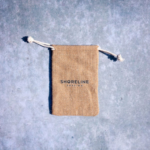 Drawstring hessian travel bag for plastic free razor on a grey background - Shoreline Shaving