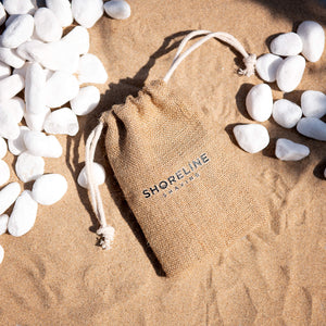 Hessian travel bag on sand - Shoreline Shaving