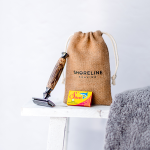 Storm Grey safety razor leaning against a hessian bag with a white towel in the foreground - Shoreline Shaving