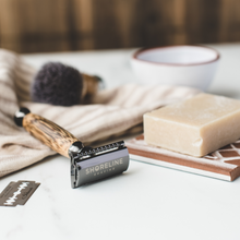 Load image into Gallery viewer, Closeup of a Shoreline Shaving safety razor with shaving soap - Shoreline Shaving