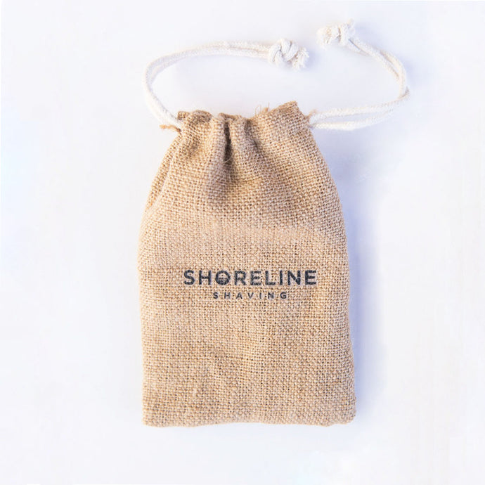 Hessian drawstring travel bag on white background, which is used to carry an eco-friendly safety razor - Shoreline Shaving