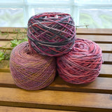2 skeins oh hand dyed knitting yarn wound into cakes