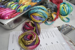 hand dyed mulberry silk fibres being packed by sally ridgway | Sally Ridgway | Shop Wool, Felt and Fibre Online