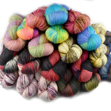 pile of multi coloured hand dyed yarn for sale by sally ridgway