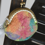 This lovely little wet felted purse has hand dyed silk fibre felted into the front creating a variegated pretty multi colour to the bright green base.