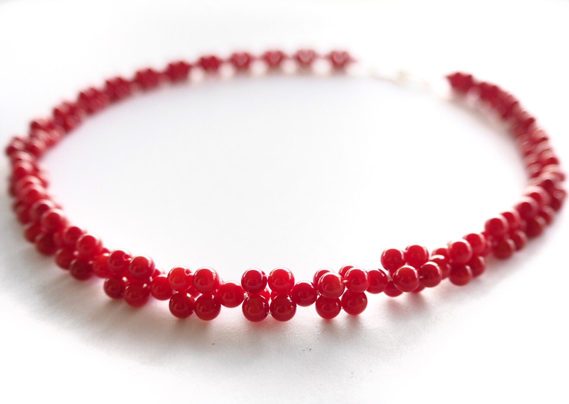Coral - Red crossed coral necklace with sterling silver hook clasp