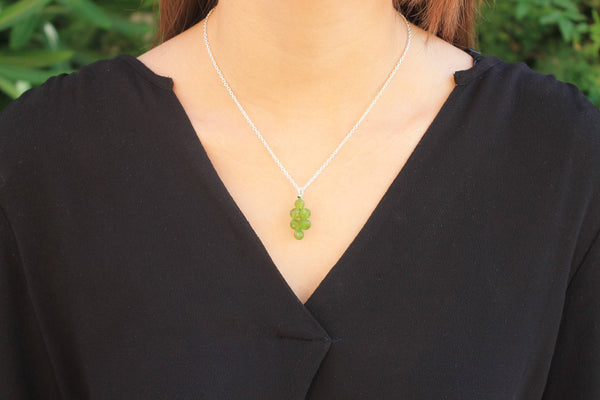 Peridot pendant and silver chain necklace
