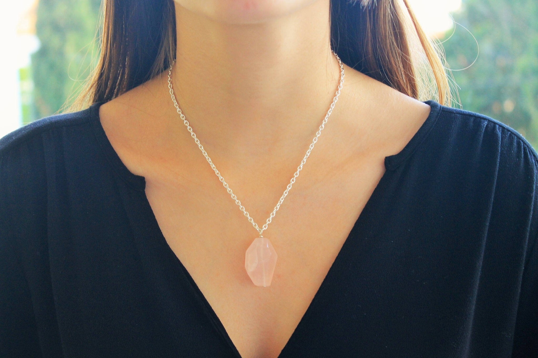 Rose quartz pendant and silver chain necklace