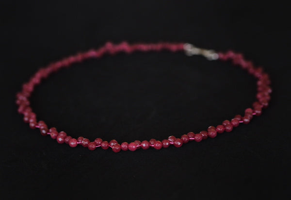 Ruby - Ruby necklace with a twist