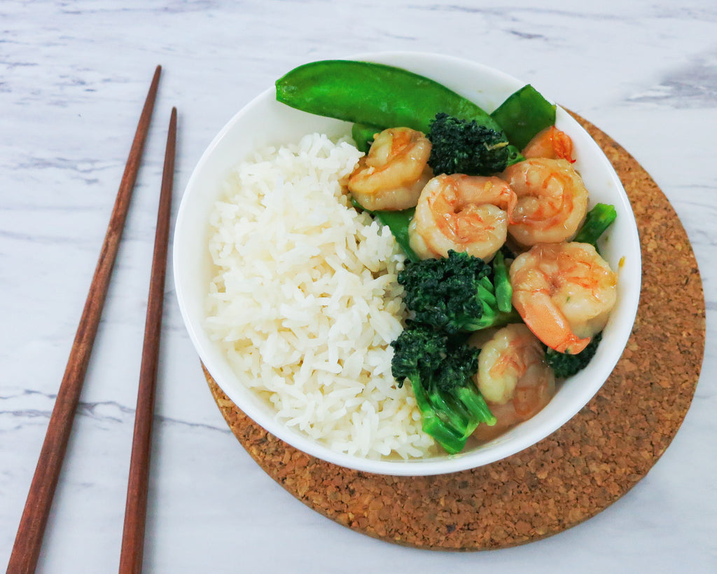 Shrimp stir fry with broccoli and snow peas over rice
