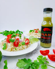 glass noodle salad with a bottle of nam prik chili sauce