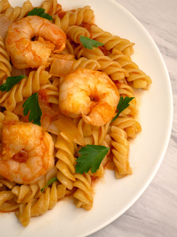 close up of pasta and shrimp in tomato sauce