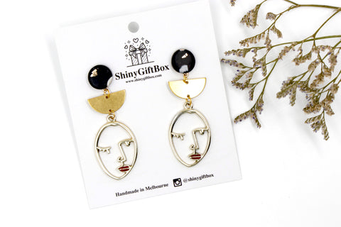 Black & Gold Face Red Lips Dangle