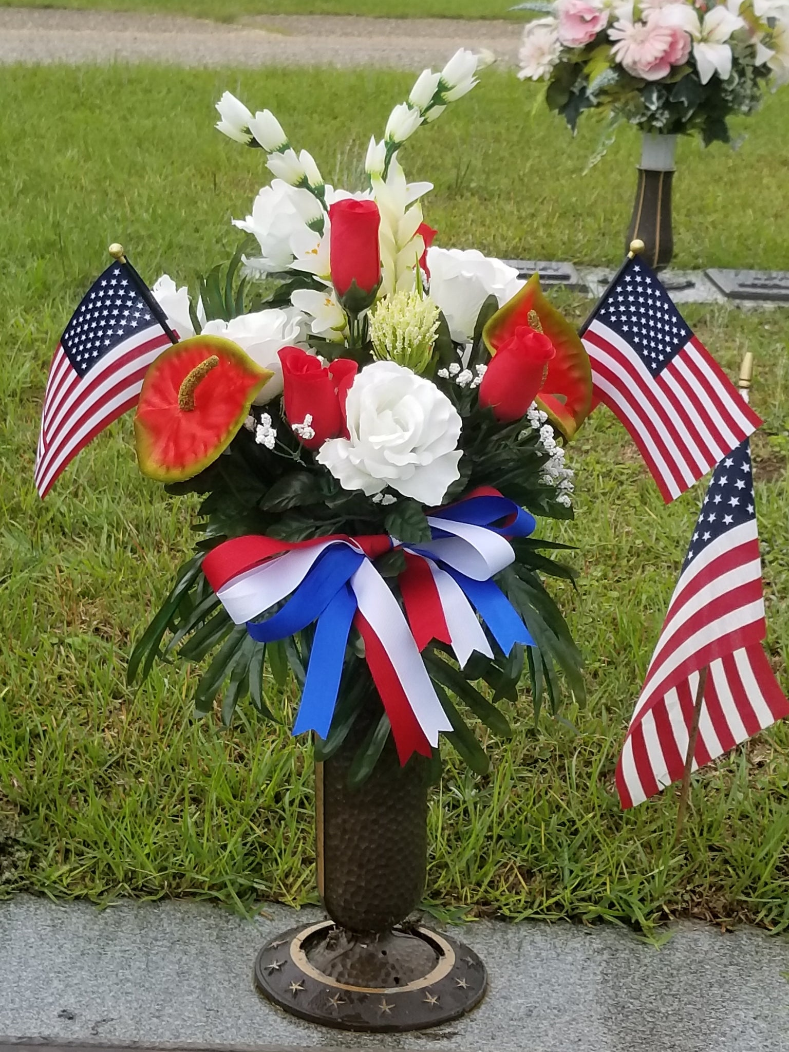 Red And White With Bow And Flags Arrangement Show Off Headstones