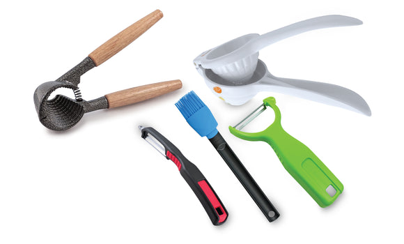 Swissmar kitchen tool assortment. Includes nut cracker, citrus press, peelers and a silicone brush