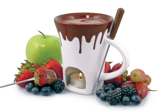 Swissmar Nostalgia 4 Pc Chocolate Fondue Mug Set with melted chocolate inside and the tealight candle lit with fruit surrounding the fondue