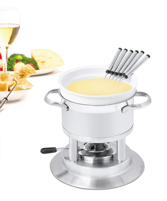 Swissmar Arosa 11 Pc Stainless Steel Fondue Set filled with melted cheese with food off in the distance