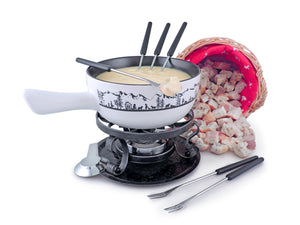 Swissmar Heidi 9 Pc Ceramic Fondue Set with melted cheese in the fondue and some cut up pieces of bread in a basket next to it