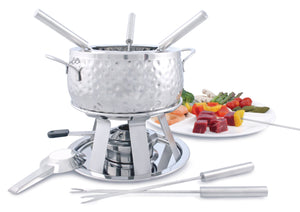 Swissmar Bienne 11 Pc Stainless Steel Fondue Set with plate of food in the background