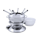 Swissmar Züri 11 Pc Stainless Steel Fondue Set with splatter guard on top and the ceramic bowl off to the side