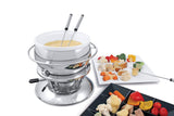 Swissmar Züri 11 Pc Stainless Steel Fondue Set with ceramic insert filled with cheese with various vegetables and bread spread around