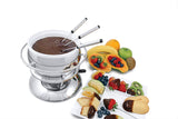 Swissmar Züri 11 Pc Stainless Steel Fondue Set with ceramic insert filled with chocolate with assorted fruit spread around