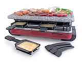 raclette with food on granite stone top, a raclette dish with melted cheese in front
