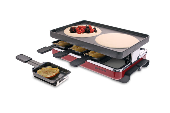 raclette with crepes cooking on top and fruit in a raclette dish in front