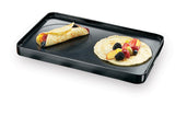 Swissmar Cast Aluminum Reversible Non-Stick Grill Plate crepe side with crepes on top