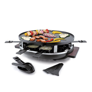 raclette with food grilling on top, empty raclette dishes in front