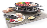 raclette with food on grill top, sliced bread slightly behind raclette, a raclette dish with melted cheese in front and a plate full of vegetables