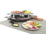 raclette with food on granite stone top, a raclette dish with melted cheese in front of the raclette and a plate full of food