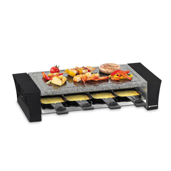 raclette with food on granite stone top, a raclette dish with melted cheese underneath
