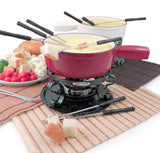 Swissmar Lugano 9 Pc Cast Iron Fondue Set in red shown full of cheese with cubed bread on fondue forks around it
