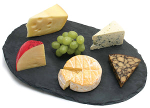 Swissmar Oval Slate Board with various cheeses on top
