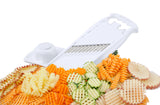 Börner White PowerLine Wave Waffle Cutter with sliced assorted vegetables laid out around it and a food safety holder off to one side