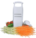 Börner White PowerLine Thin Julienne Slicer Standing upright with julienne vegetables spread out around it