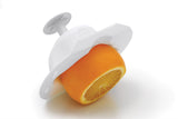 White Food Safety Holder with a partially sliced orange inside