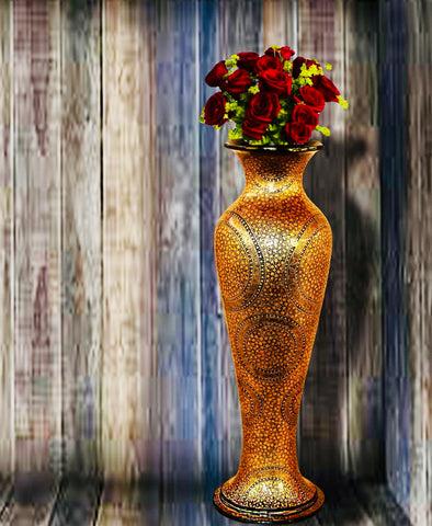 Gold paper mache vase with roses inside